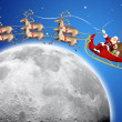 Santa Claus in his deer sled - Stock Photo