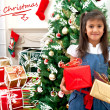 Christmas girl with presents — Stock Photo