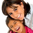 Mother and daughter smiling — Stockfoto #7741513