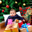Baby with Christmas presents — Stock Photo