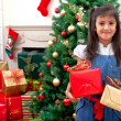 Girl with christmas gifts — Stock Photo #7741532