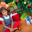 Girl next to a Christmas tree — Stock Photo