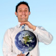 Business man holding earth — Stock Photo