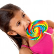 Royalty-Free Stock Photo: Girl eating a candy