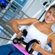 Woman at the gym exercising — Stock Photo #7741719