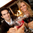 Friends toasting at dinner — Stock Photo