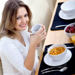 Stock Photo: Woman eating her breakfast