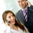Stock Photo: Business couple with cellular