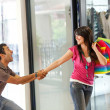 Man keeping a woman from entering a store - Stock Photo