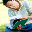 Student reading a book outdoors — Stock Photo #7741891