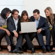 Business group with a laptop — Stock Photo