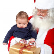 Santa and a baby — Stock Photo