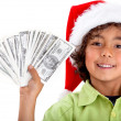 Christmas boy with money — Stock Photo