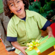 Stock Photo: Kid opening gift