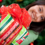 Woman giving a Christmas gift — Stock Photo #7742063
