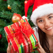Woman with Christmas gift - Photo