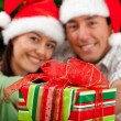 Christmas couple with a present — Stock Photo