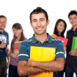 Student with a group behind — Stock Photo