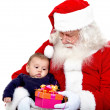 Santa Claus with a baby — Stock Photo