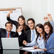 Successful business group with laptop — Stock Photo