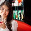 Woman at the bar — Stock Photo