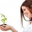 Woman holding a plant — Stock Photo