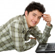 Young man with a laptop — Stock Photo