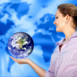 Woman with the world in her hands — Stock Photo #7742829