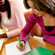 Female student writing — Stockfoto