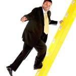 Business man climbing a ladder — Stock Photo #7744838