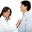 Royalty-Free Stock Photo: Doctor assessing a patient