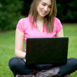 Stock Photo: Woman with a laptop outdoors
