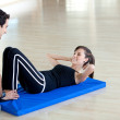 Stock Photo: Gym woman with trainer