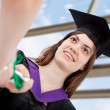 Grad student getting her diploma — Stock Photo
