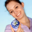 Woman with the world in her hands — Stock Photo