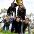 Human pyramid outdoors - Stock Photo