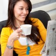 Woman reading the newspaper — Stock Photo