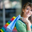 Shopping woman at a mall - Foto de Stock