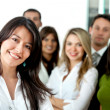 Business woman with a group - Stock Photo