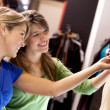 Stock Photo: Women looking at clothes