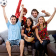 Watching football - Stock Photo