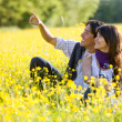 Couple outdoors pointing — Stock Photo