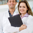 Young doctors smiling — Stock Photo