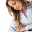 Female doctor writing - Stock Photo