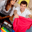 Stock Photo: Shopping couple at home