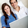 Stock Photo: Couple working at home