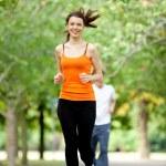 Woman jogging outdoors — Stock Photo