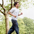 Stock Photo: Fit man jogging
