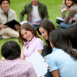 Students sitting outdoors — Stock Photo