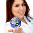 Doctor with a globe — Stock fotografie